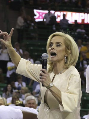 Baylor head women's coach Kim Mulkey celebrates her 500th career win with forward Nina Davis, right, following an NCAA college basketball game against Texas Tech.