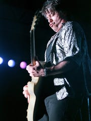 -  -George Thorogood performs with his band, The Destroyers.