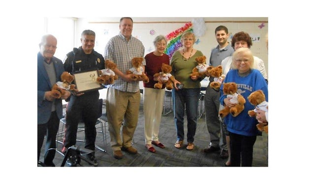 (From left) Bruce Middleton, Armando Pineda, supervisor of Vineland Emergency Medical Services, Chris Volker, Lois Middleton, Alma Pesiri, Mike Regenelli, Rosemary DiQuinzio and BJ Giercyk, hold Hug-A-Bears. Pineda attended a meeting of the Vineland Service Clubs Council to share information about Emergency Medical Services in Vineland.
