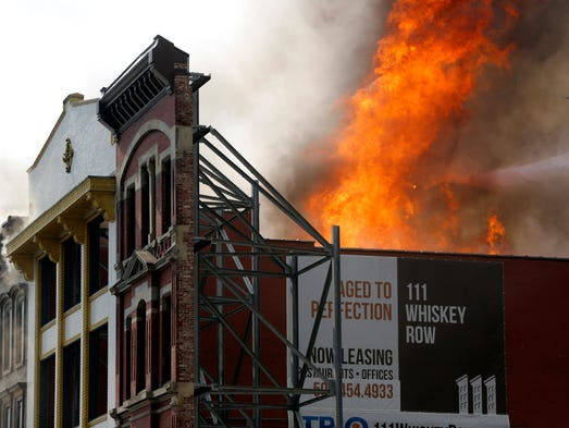Fire on Whiskey Row, Main Street Louisville.  By Pat