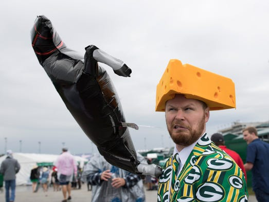 Bob Nictoli and his Green Bay cheesehead hat and horse