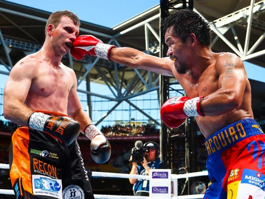 Manny Pacquiao (R) of the Philippines fight Jeff Horn