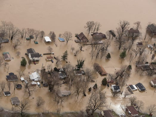 Homes in Utica, Ind. sit submerged in the floodwaters