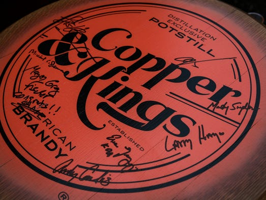 A Copper & Kings barrel top signed by members that