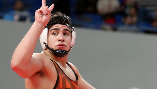 Sprague's Santos Cantu III holds up two fingers after winning his second-straight state title in the OSAA Wrestling State Championships Class 6A weight 195 at Veterans Memorial Coliseum in Portland on Saturday, Feb. 17, 2018.