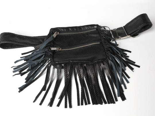 Waist Bag: Perfect for festival season or a morning at the farmer's market, this fringe waist bag will be your go-to accessory this summer. Velvet Coat, $419.