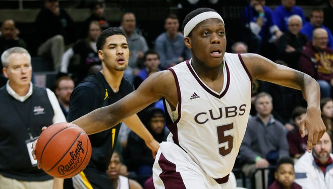 Detroit U-D Jesuit's Cassius Winston scores 31 points against North Farmington during the MHSAA boys basketball Class A finals March 26, 2016 at the Breslin Center in East Lansing.