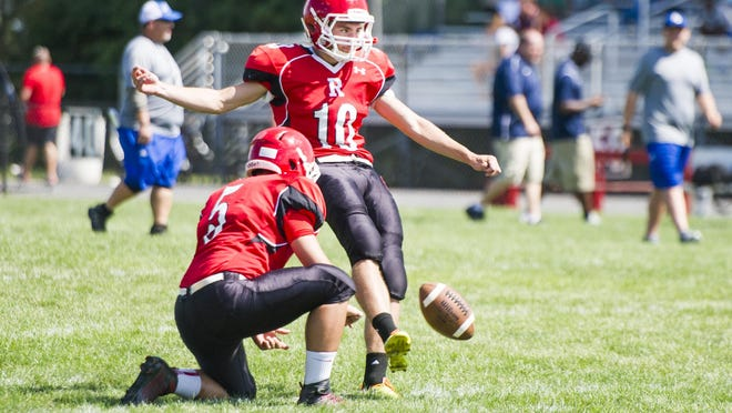 Riverheads' kicker Tristan Robson warms up by kicking field goals before their pre-season scrimmage against James River in Greenville on Saturday, Aug. 22, 2015.