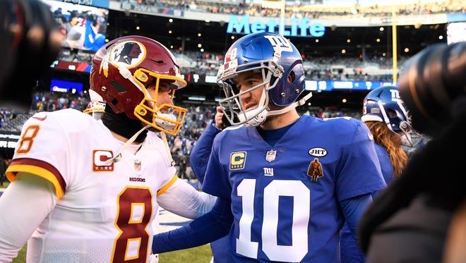 Washington Redskins quarterback Kirk Cousins (8) and New York Giants quarterback Eli Manning (10) talk after the game. The New York Giants defeat the Washington Redskins 18-10 in East Rutherford, NJ on Sunday, December 31, 2017.