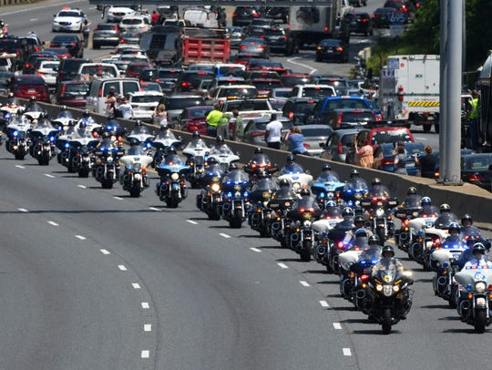 The funeral procession for Officer Amy Caprio passes