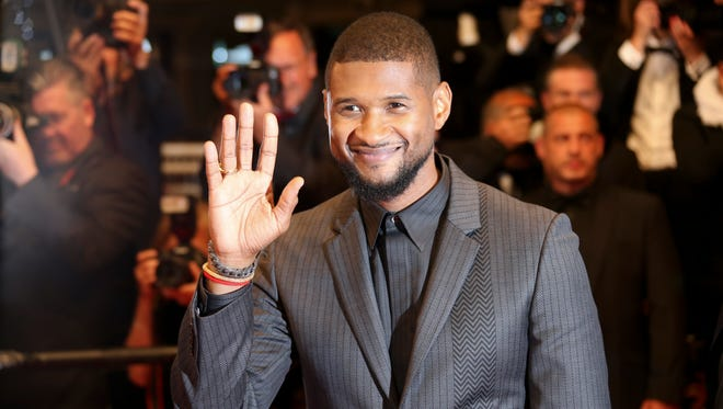 Actor Usher Raymond IV poses for photographers upon arrival at the screening of the film Hands of Stone at the 69th international film festival, Cannes, southern France, Monday, May 16, 2016. (AP Photo/Joel Ryan)