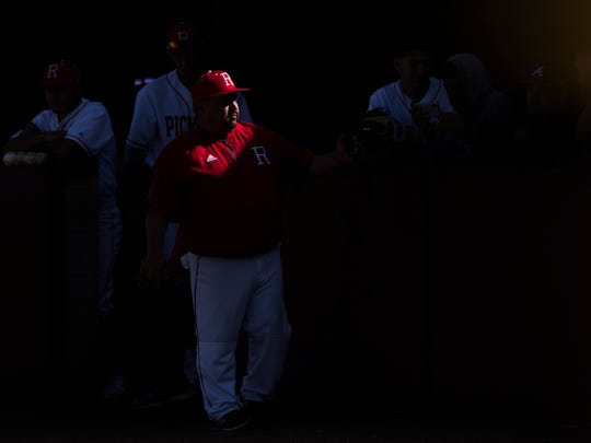 Robstown assitant coach Lee Roy Gonzalez talks to his players during their game Thursday, March 1, 2018 at Calallen High School