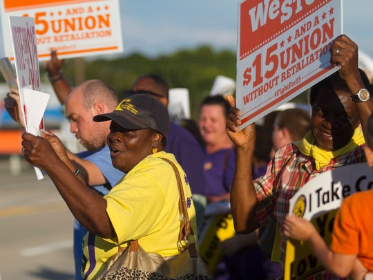 Veronica Miller and other protesters ask for $15 an hour wages on Tuesday in North Fort Myers.