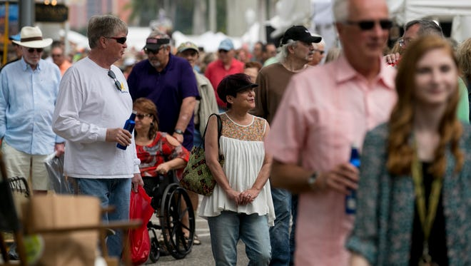 Thousands of people came to downtown Fort Myers on Saturday to see hundreds of booths filled with art by artists throughout the country at ArtFest. The event continues on Sunday.