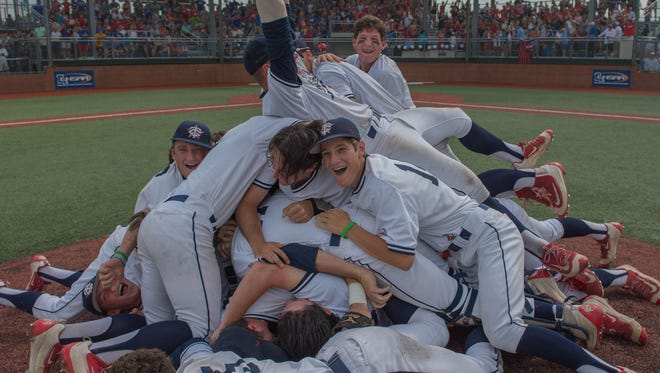 -Teurlings Catholic Rebels celebrate on the mound after defeating West Quachita by a final score of 3-2 in the LHSAA class 4A final on Saturday.