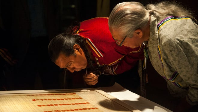 Oren Lyons, right, faithkeeper of the Turtle Clan of the Onondaga Nation, and Sidney Hill, the Tadodaho of the Haudenosaunee Confederacy, examine the signature of Ki-On-Twog-Ky, also known as Cornplanter (Seneca), on the Canandaigua Treaty in September. The treaty, also signed by George Washington, is on loan to the Smithsonian's National Museum of the American Indian.