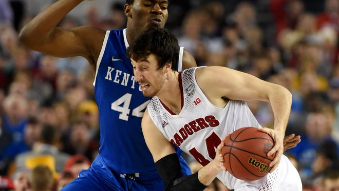 Apr 5, 2014: Wisconsin Badgers forward Frank Kaminsky (right) drives against Kentucky Wildcats center Dakari Johnson in the second half during the semifinals of the Final Four.