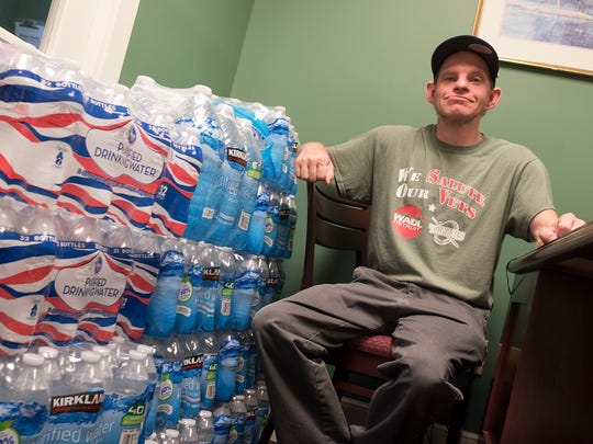 Jimmy Crowley collects donations of bottled water for Flint residents.
