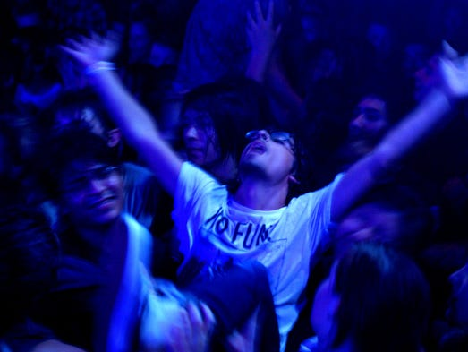 A crowd surfer revels in his feat after diving off stage during Playboy Manbaby, Saturday, August 23, at Crescent Ballroom in Downtown Phoenix.