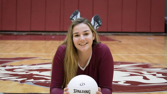 First Baptist volleball player Katie Gilchrist poses for a photo at on her home court.
