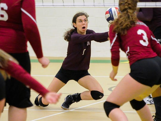 Henderson County's Morgan Farris (5) goes for the ball during Second Region volleyball tournament game against Madisonville at University Heights Academy in Hopkinsville, Wednesday, Oct. 26, 2016. Henderson County beat Madisonville 3-0.