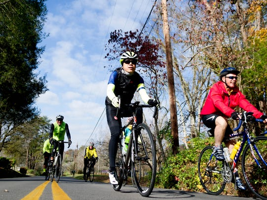 Bikers ride down a rural road during a group bike ride in Maryville, Tennessee, on Tuesday, November 14, 2017. Knox Regional TPO created a map of all walker/biker accidents with cars and found that Alcoa has the most per capita.