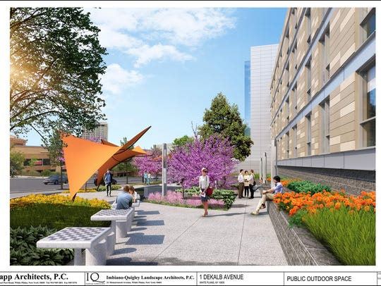 Rendering of public area outside of new apartment building
