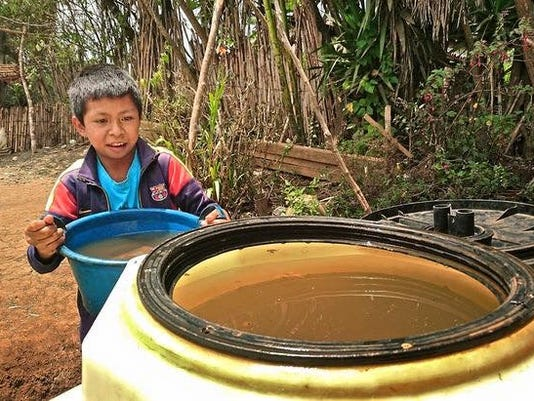 636265018899913406-Boy-at-Water-Container.JPG