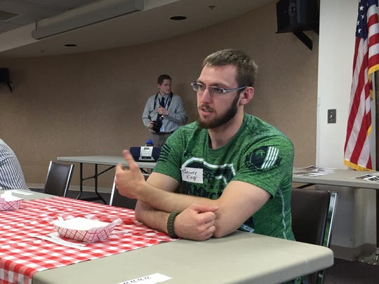 Wausau resident Lance King chats during one of the
