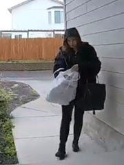 A surveillance camera caught a woman stealing a package