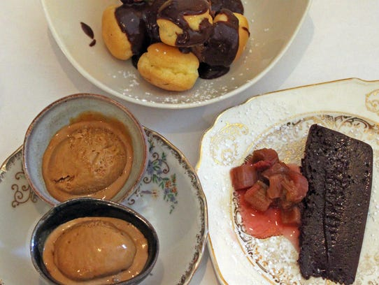 Desserts (clockwise, from top): chocolate mousse in