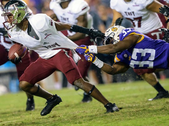 Troy cornerback Marcus Jones (8) is tackled on a return against LSU safety Todd Harris Jr. (33) in the second half of an NCAA college football game in Baton Rouge, La., Saturday, Sept. 30, 2017. (AP Photo/Matthew Hinton)