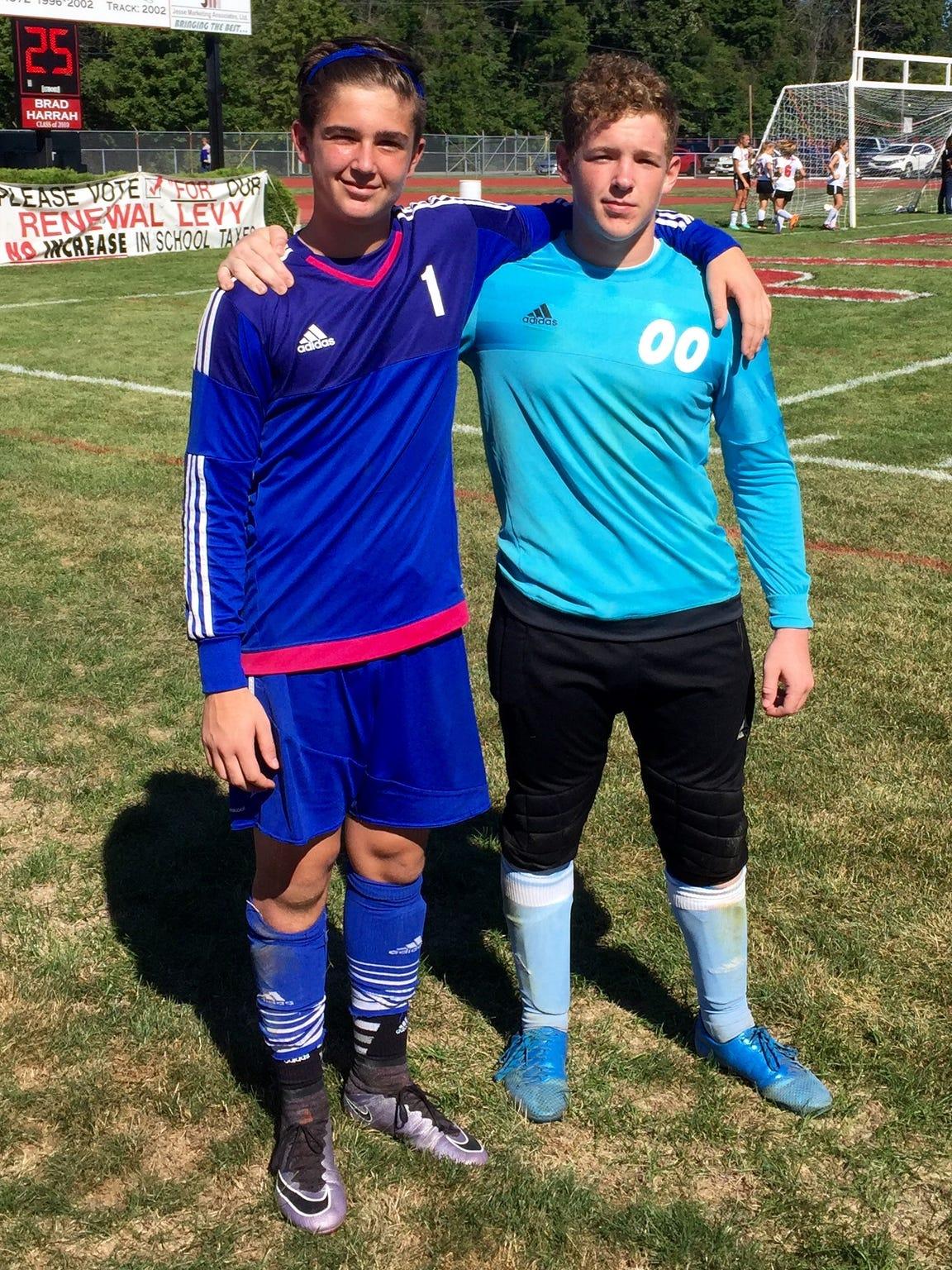 Pleasant's Evan Roark, left, and River Valley's Carter
