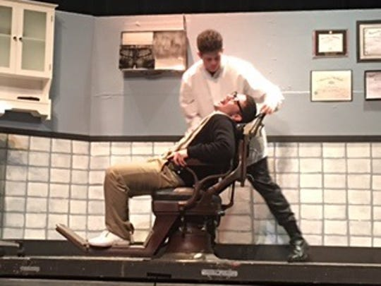 "The Dentist, played by Sammy Vivace, works on Seymour, played by Jordan Riguzzi, in Roy C. Ketchum's ""Little Shop of Horrors."""
