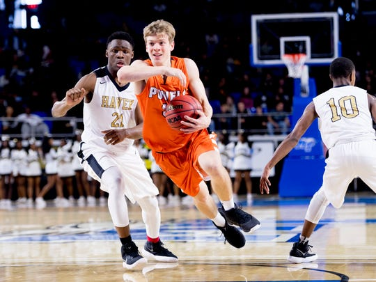 Powell's Caleb Tripp (32) dribbles down the court past Whitehaven's Devine Owens (21) during a Division I Class AAA quarterfinals game at the TSSAA boys state basketball championships in Murfreesboro, Wednesday, March 14.