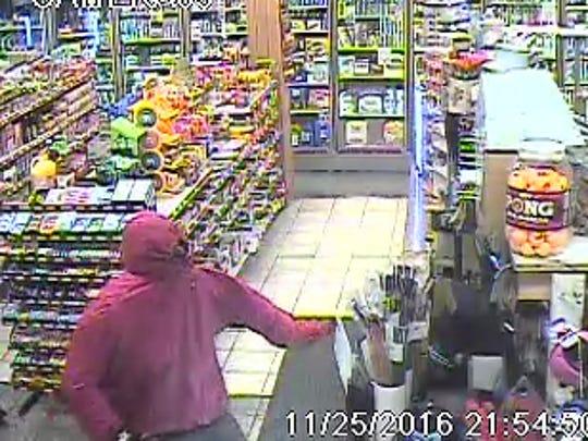 Surveillance footage shows two men police say robbed Rinku's Food Market on Walnut Street in Elmira Nov. 25.