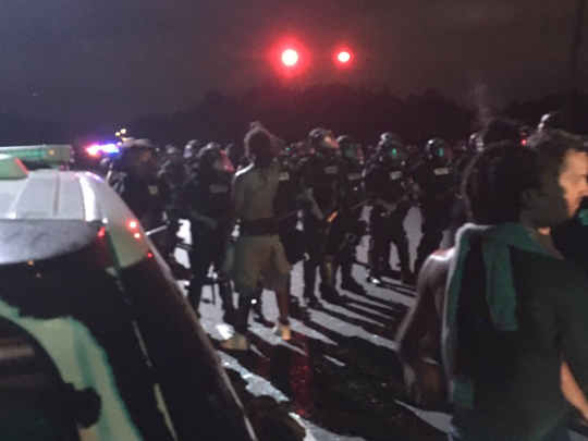 Protesters face off with Charlotte-Mecklenburg Police officers in north Charlotte Sept. 20, 2016.