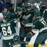 Minnesota Wild forward Jason Pominville (center) celebrates his goal with teammates during the second period against the Chicago Blackhawks in game four of the second round of the 2014 Stanley Cup Playoffs at Xcel Energy Center.