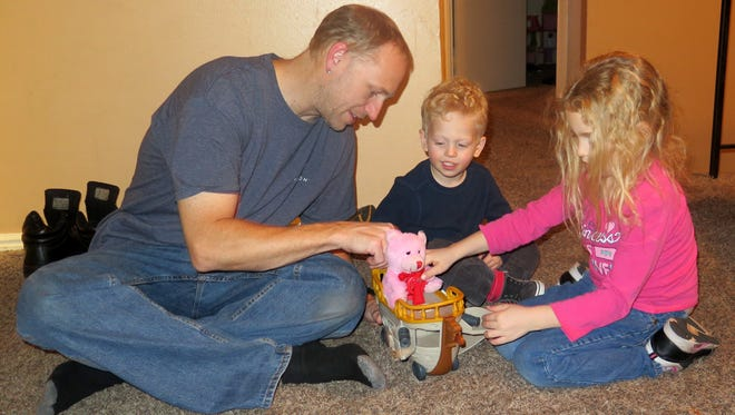 Aaron Wilson and his children Kai, 4, and Anya, 7, play together at their new apartment in St. George on Thursday, Nov. 5, 2015.