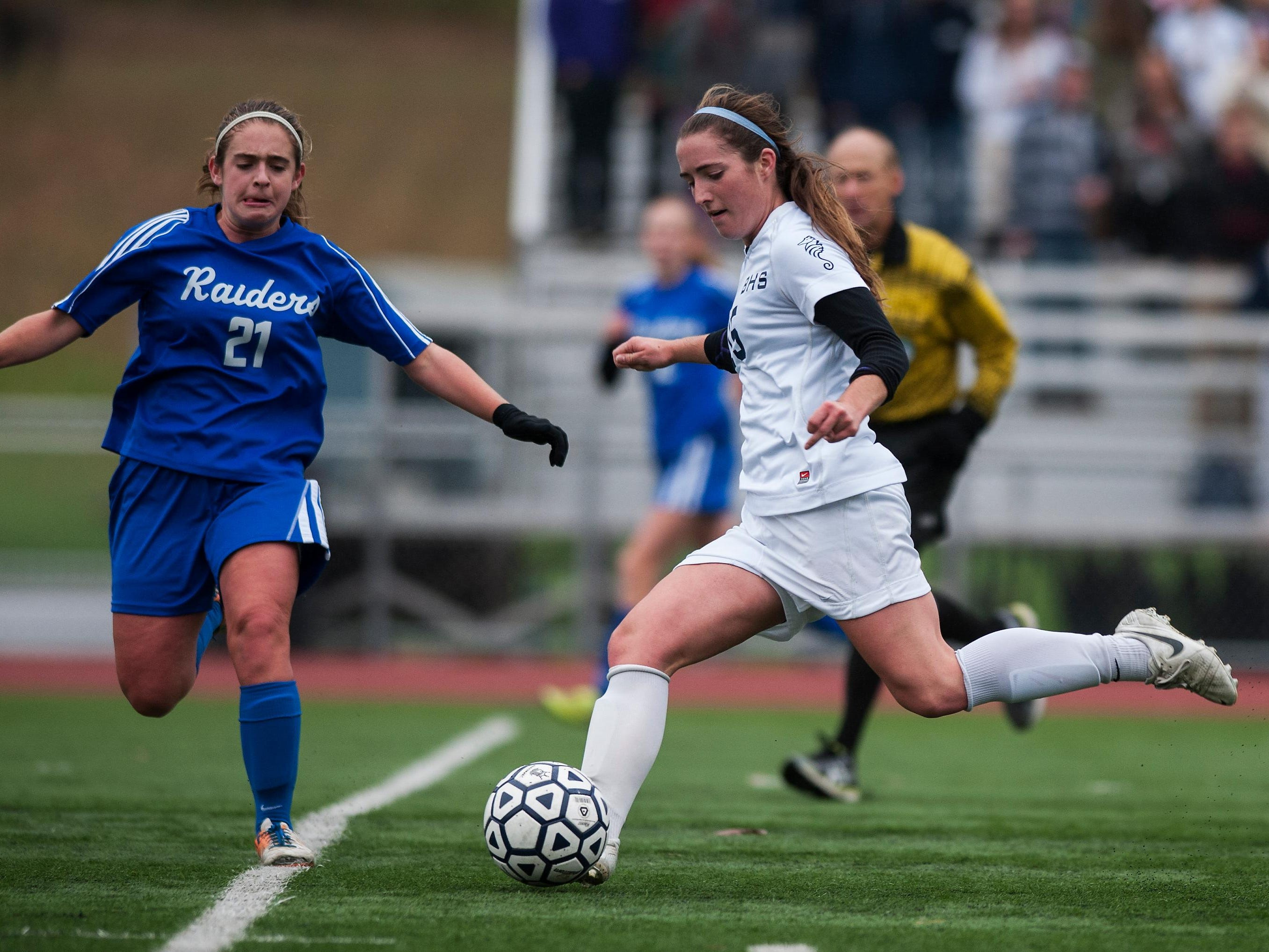 Burlington's Madison Feeney (15) takes a shot during a high school girls playoff soccer game in 2014.