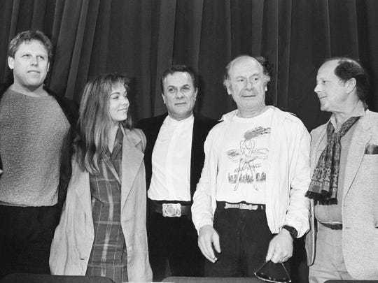 "In this May 11 1985 file photo, from left, actors Gary Busey, Theresa Russell, Tony Curtis, Michael Emil, and director Nicolas Roeg answer newsmen during a press conference for ""Insignificance"" at the 38th Cannes International Film Festival, held in the festival palace for their film in competition, in Cannes."