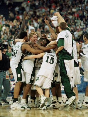 Mateen Cleaves #12 (C) of Michigan State is mobbed by his teammates after defeating Florida 89-76 to win the final round of the NCAA Men''s Final Four at the RCA Dome in Indianapolis, Indiana.