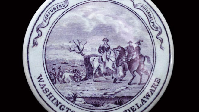 """This pot lid was made in Pennsylvania about 1845 to 1860, and it has a rare purple transfer picturing """"Washington Crossing the Delaware."""" It sold at auction for more than $3,000."""