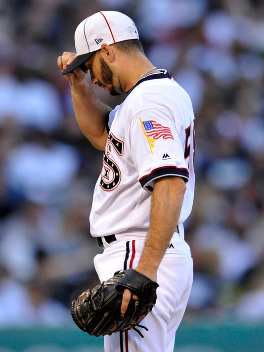 Chicago White Sox starting pitcher Miguel Gonzalez reacts after giving up an RBI ground-rule double to Austin Jackson during the third inning of a baseball game against the Cleveland Indians, Saturday, July 29, 2017, in Chicago. (AP Photo/Paul Beaty)