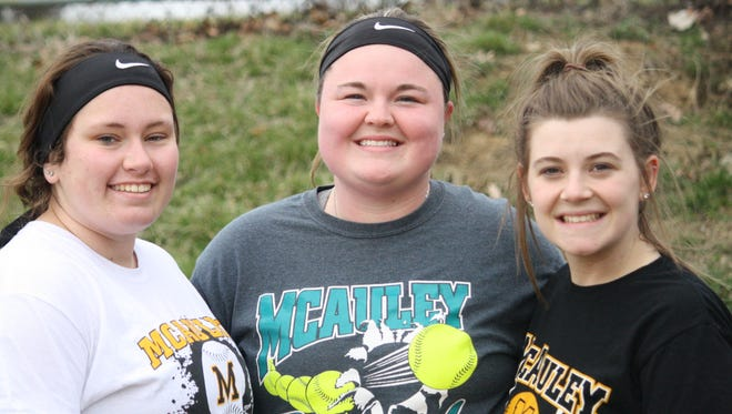 McAuley's three seniors get ready for practice March 18. They are, from left, Morgan Wells, Kenzie Anderson and Megan Rutz.