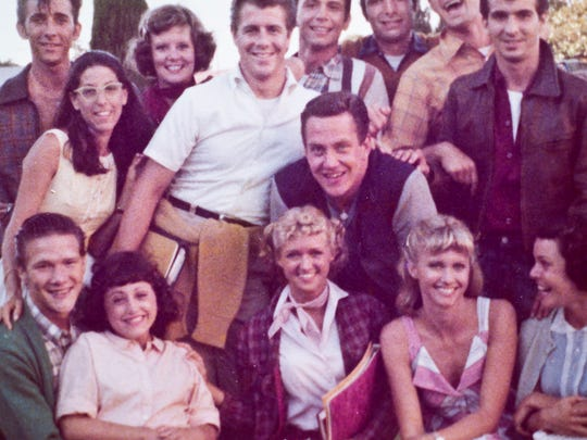 """Dancer Sean Moran, center, a Burlington native, poses with Olivia Newton John, lower right, and fellow dancers on the movie set of """"Grease."""""""