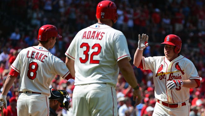 May 21, 2016: St. Louis Cardinals second baseman Jedd Gyorko (3) is congratulated by starting pitcher Mike Leake (8) and first baseman Matt Adams (32) after hitting a two run home run off of Arizona Diamondbacks starting pitcher Robbie Ray (not pictured) during the second inning at Busch Stadium.