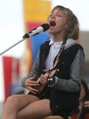 Grace VanderWaal performs during a summer-concert series