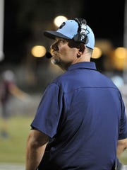 Shaun Ball is the head football coach at Redwood High