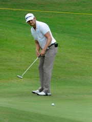 David Holmes putts on the 9th green during the second round of the News Sentinel Open Friday, Aug. 16, 2013 at Fox Den Country Club.